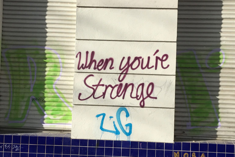 """When you are strange""-Graffiti in Neukölln"